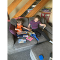 Jacob reading with his big sister.