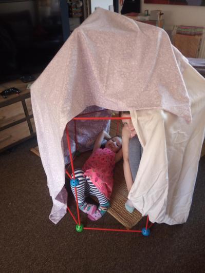 Harriet building a great den