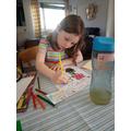 Harriet working hard with her maths work