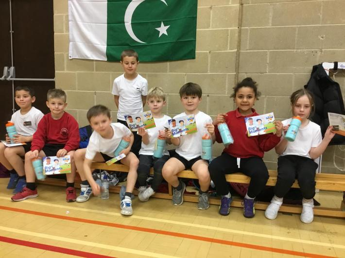 Celebrating with their certificates