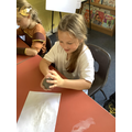 We pinched the clay between finger and thumb.