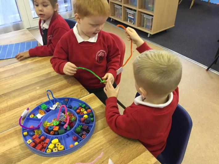 threading numbers to develop fine motor control and recap on our numbers.jpg