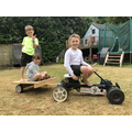 Ava on the go cart she made with her family