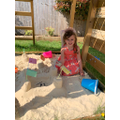 Emily playing in the sand. Great castle Emily!
