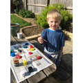 Dillon completing his Easter painting