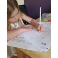 Talia busy with maths.