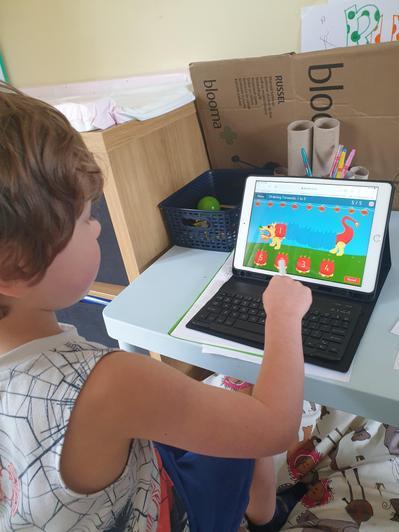 Rupert working on his maths.