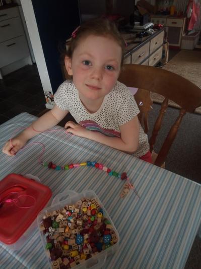 Harriet threading beads