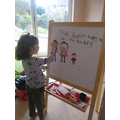 Martha doing some beautiful drawing and writing.