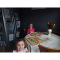 Daisy is decorating cookies with her sister.