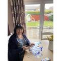 Mrs Hopegood busy making bookmarks.