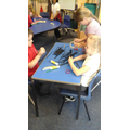 Children trying to build a standing Eiffel Tower