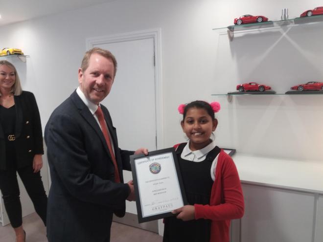 This is Alizah winning her Ferrari award.