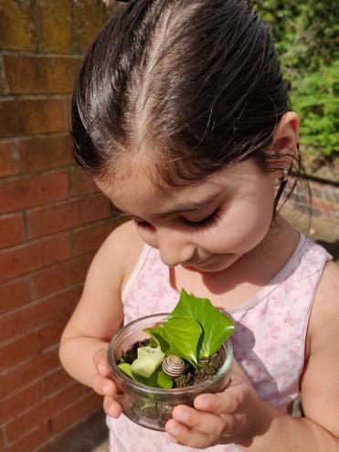 Manvita taking care of 'Cutie'.the snail