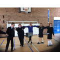 Mrs Brewer and year 11 students dancing