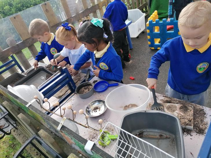 Exploring in our mud kitchen