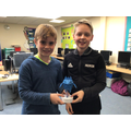 Two Year 5s, having built their Internet Legend trophy.