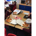 Enjoying our pizzas back at school