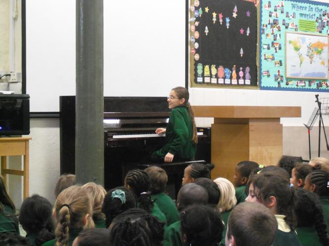 A pupil performs on the piano
