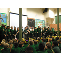 A class perform in a poetry recital assembly