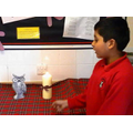 A candle helps us think in Assembly with Mrs Eade.