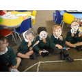 using puppets and masks to tell the story