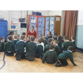 The children discuss the messages in the play.