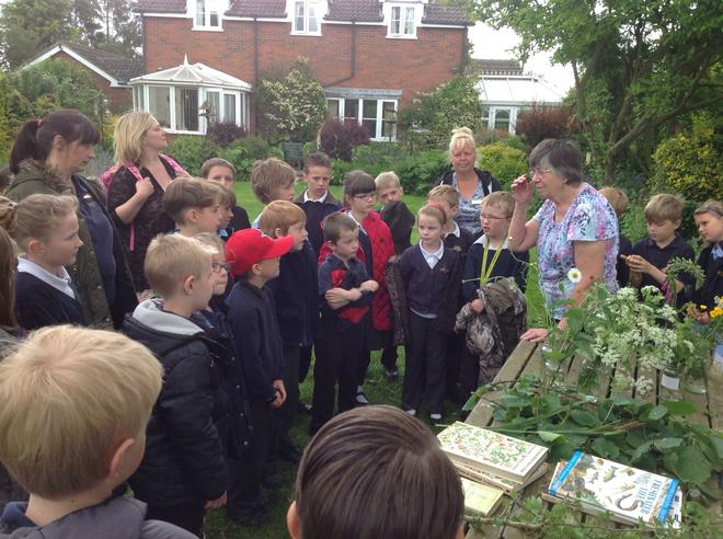 Mrs Hollings welcomes us to her garden.