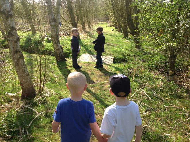 Walking through the orchard, identifying trees.