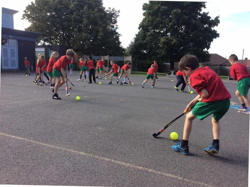 Children enjoying hockey in the junior playground
