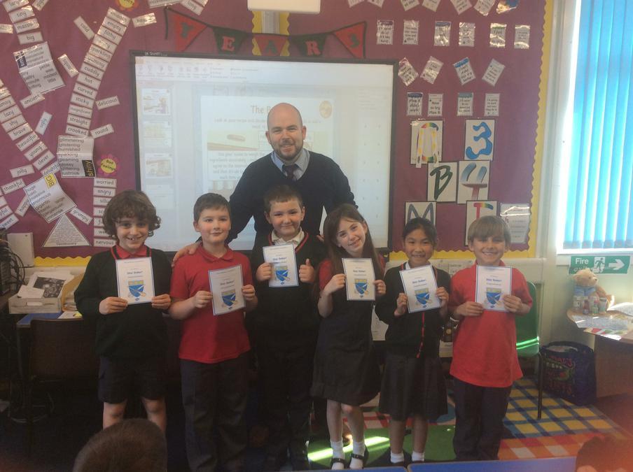 Mr McConnell handing out Star Baker Certificates