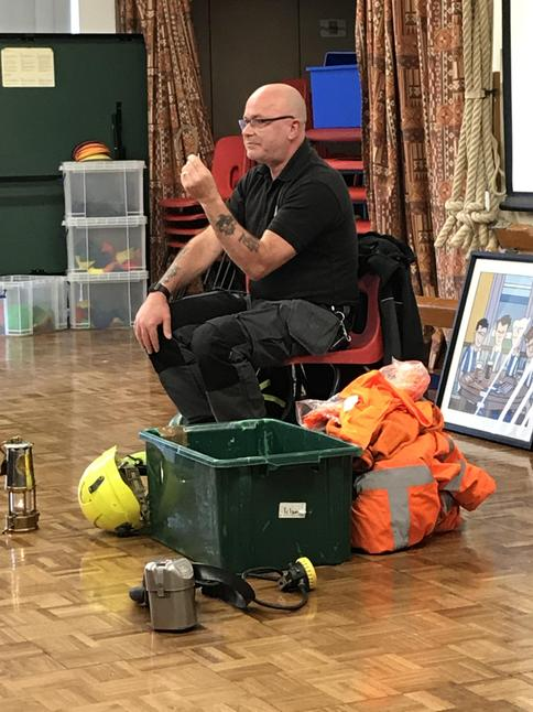 Mr Wall showing the children some of the equipment used in the mines.