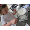 Sieving flour for cup cakes
