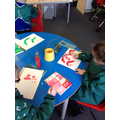 The children used their tints and shades to paint a picture they had drawn.