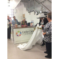 High Sheriff of Surrey, Mrs Elizabeth Kennedy, unveils the Cedar Centre Community Hub welcome desk