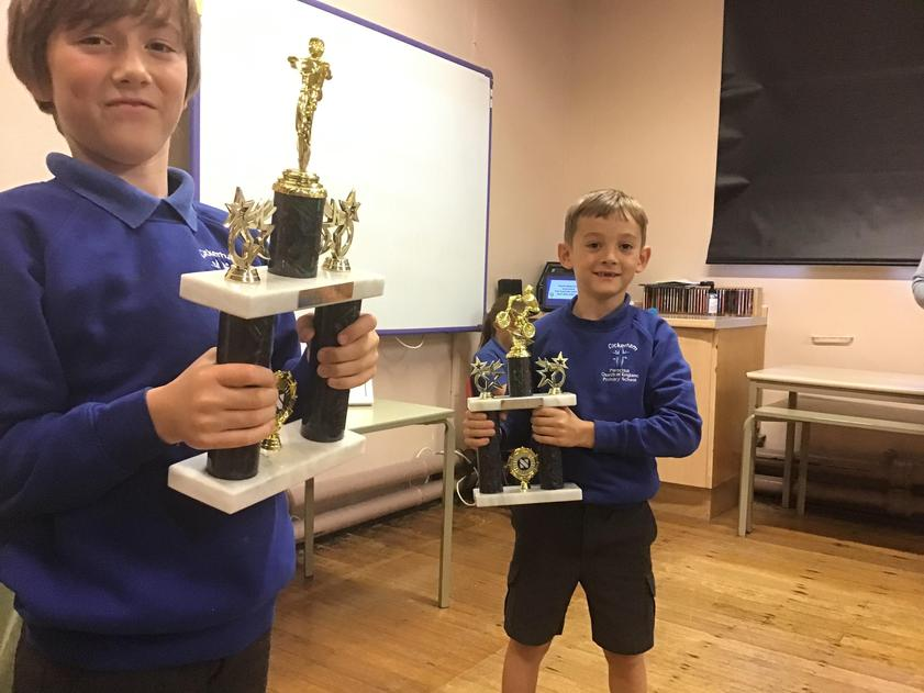 Hugo and Henry won trophies for BMX riding at a competition