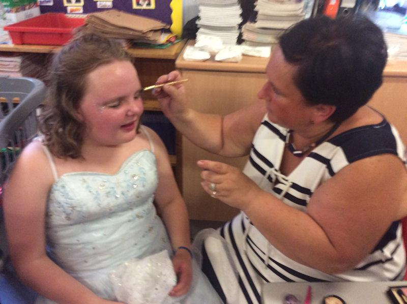 Mrs Day deftly applies make-up to the Good Witch.