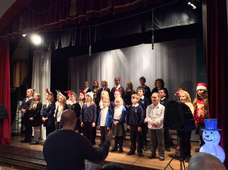 The choir sing three smashing songs.