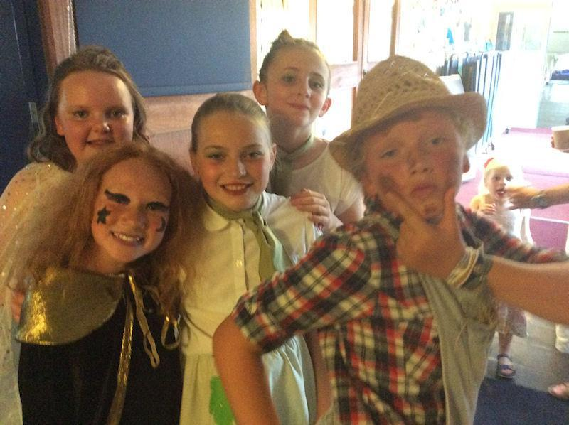 Some of the cast ready to go onstage.