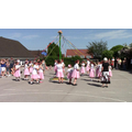 Traditional maypole dancers