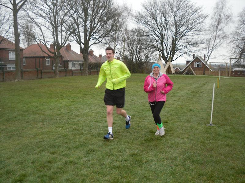 Two braver staff members in a sponsored run.