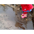 We enjoy splashing in muddy puddles.