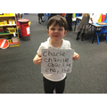 Charlie has meant he can now write his name.