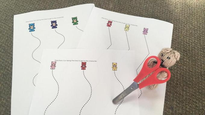 Cutting skills- Can you show your bear how you can cut along the dotted lines?