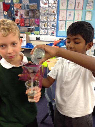 Year 5 creating a filter to clean muddy water.