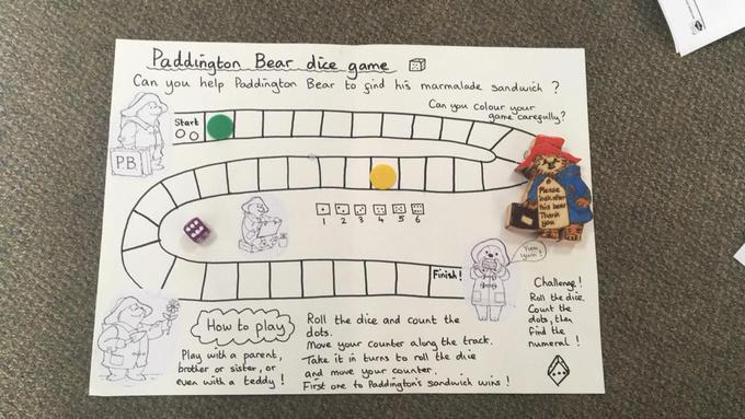 Paddington Bear game- Roll the dice and count the dots. Then move your counter forwards.
