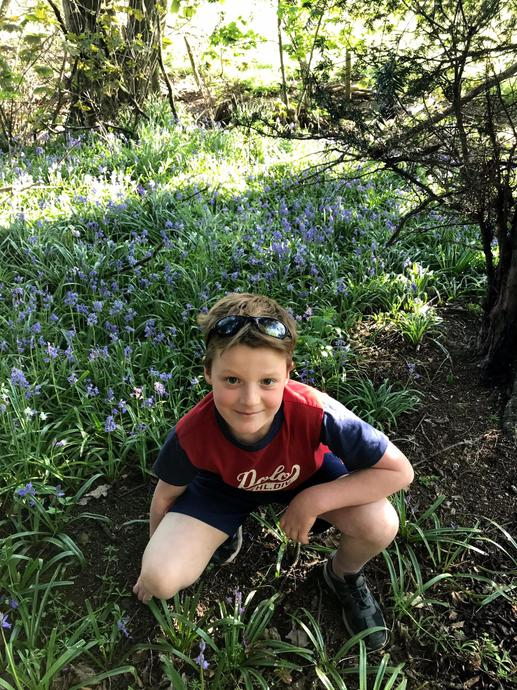 Aaron at Chantry Island smelling the bluebells.