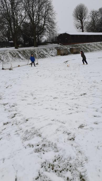 Noah playing football in the snow. Cold feet and hands!