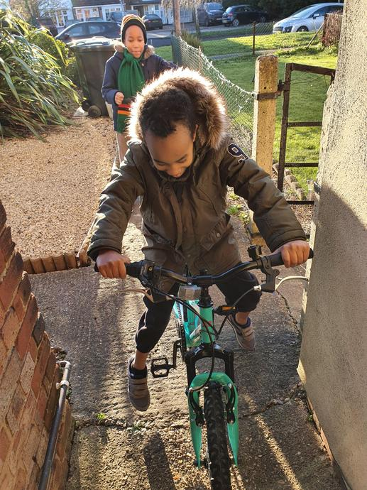 Chiny is having fun on his bike.