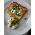 Isla made these tasty poached eggs with a parsley garnish